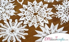 How to Cut And Create Beautiful Paper Snowflakes