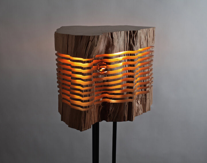 This designer turns firewood into beautiful lamps.