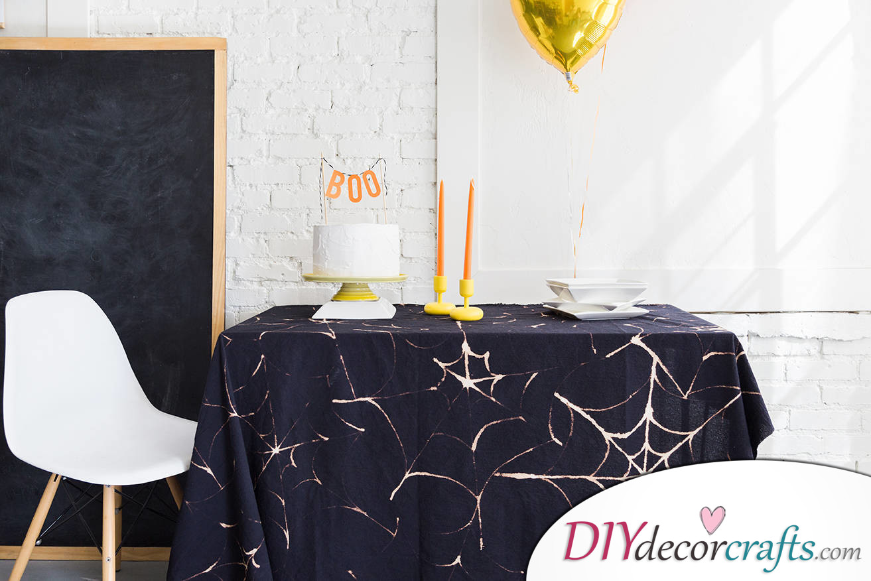 10 DIY Halloween Decor Ideas, Spiderweb Tablecloth