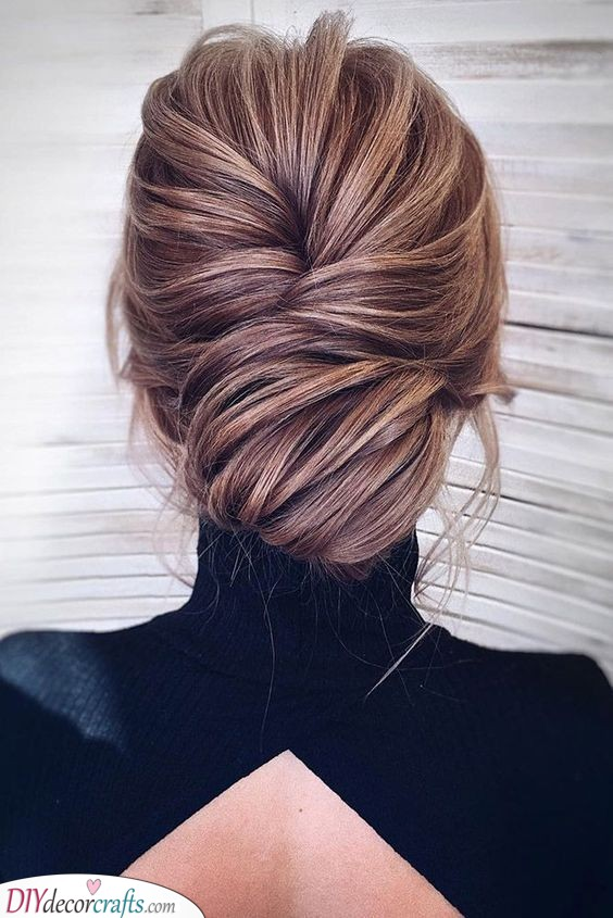 Whimsical Chignon Bun - Mother of the Bride Hairstyles