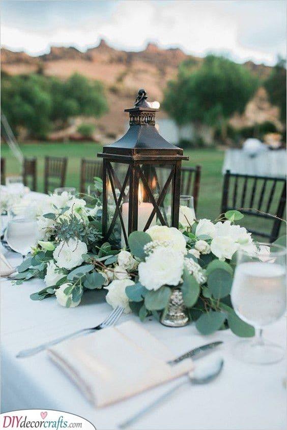 Rustic Lantern - Rustic DIY Table Centerpiece Ideas