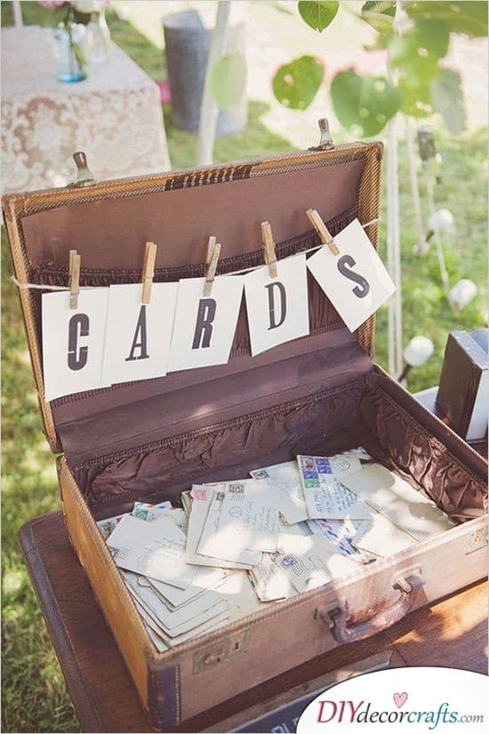 Letters Thrown into a Suitcase - Cute Wedding Guest Book Ideas
