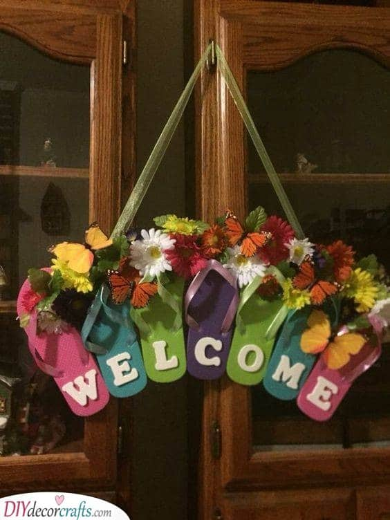 A Rainbow of Sandals - A Funny Welcome Sign
