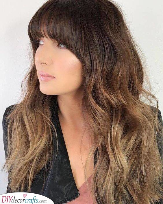 Full Bangs with Loose Waves - Long Hair Ideas