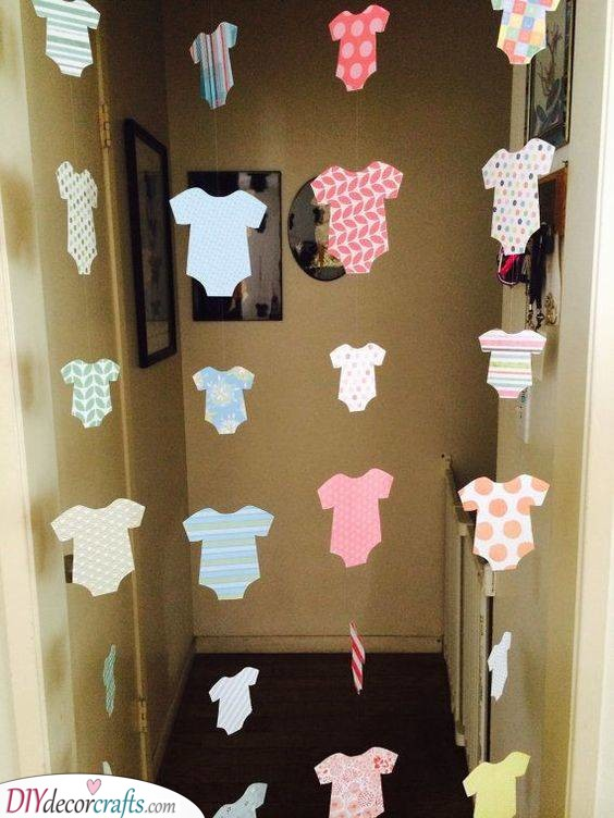Adorable Onesie Garlands - DIY Baby Shower Decorations