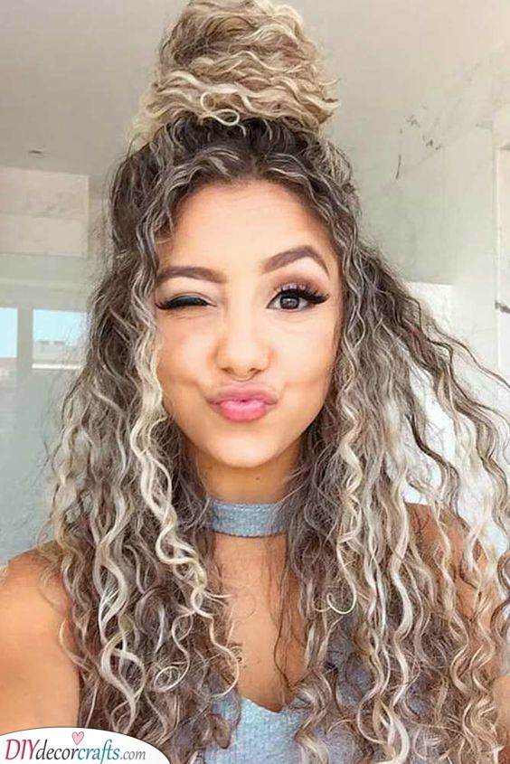 A Topknot - Great Hairstyles for Curly Hair Women
