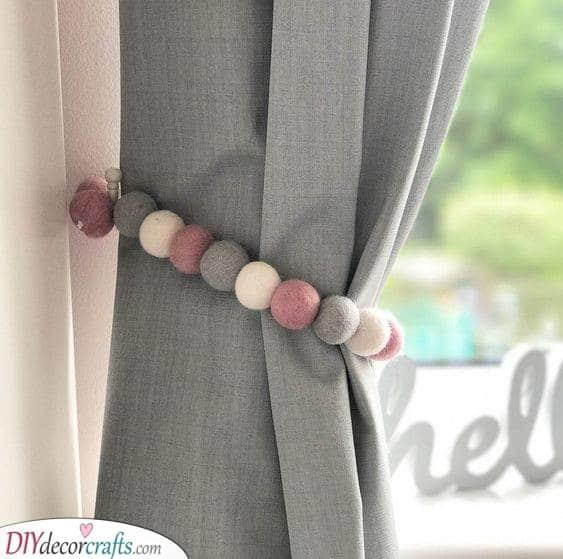 Pom Poms as Curtain Wraps - A Cute Idea