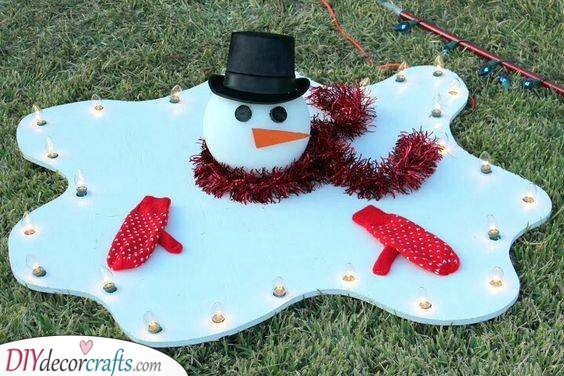 Another Melting Snowman - Turning Into a Puddle