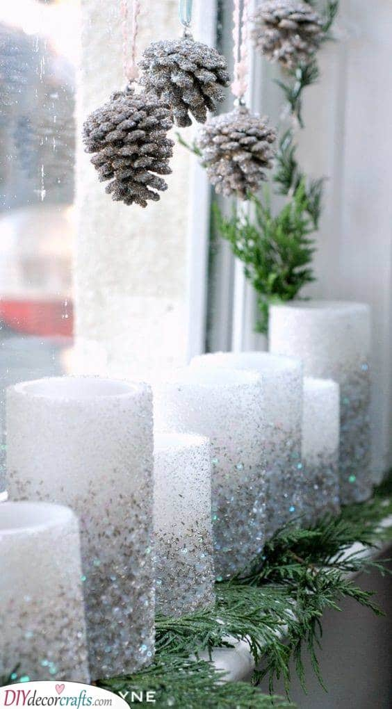 An Array of Candles - Sparkling Pinecones