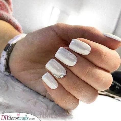 An Addition of Rhinestones - Beautiful White Nail Designs
