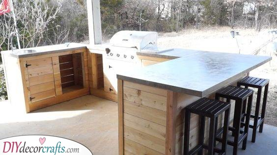 Cabinets and a Bar - Outdoor Kitchen Cabinet Ideas