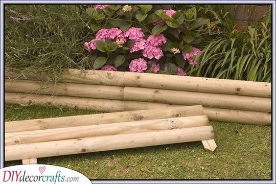 Thin Log Fence - Creative Garden Edging Ideas