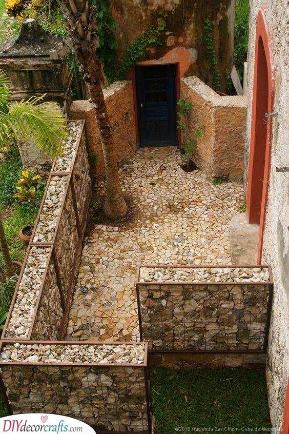 Filled with Stones and Rocks - Cheap Fence Ideas for Backyard