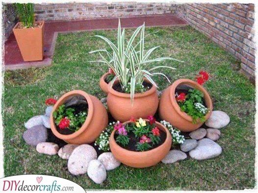 Flower Pots and Rocks - Flower Bed Designs