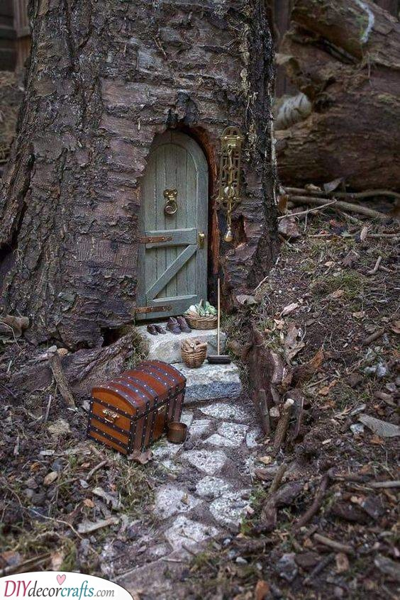 Adding Tiny Shoes - DIY Tree Stump Fairy House