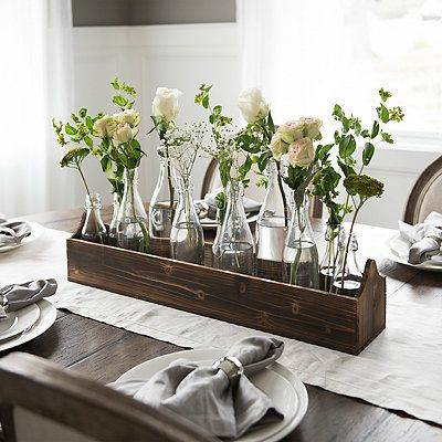 A Set of Glass Vases - With Flowers