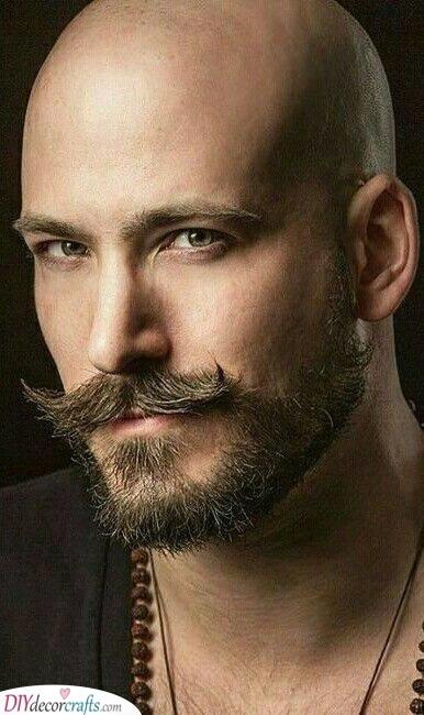 A Scruffy Beard - With a Handlebar Moustache