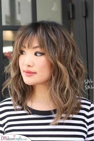 Layered Waves - Medium Haircuts for Women